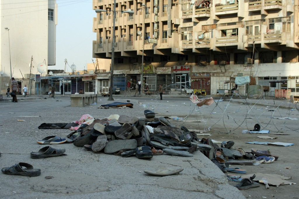 Abandoned shoes, left as people were fleeing the suicide bombing, litter the square in Baghdad. Photo by Larisa Epatko