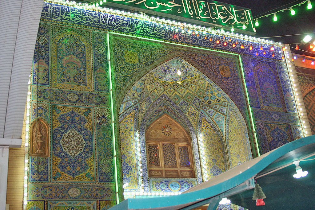 At night, the Imam Ali Mosque lights up and pilgrims flood the gates for prayer and community. Photo by Larisa Epatko