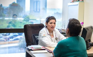 Irma Montalvo, a U.S. citizen, prefers to travel to Mexico to meet with her doctor, Cecilia Espinoza, even though she signed up for a health plan through Covered California. Photo by Heidi de Marco/KHN.