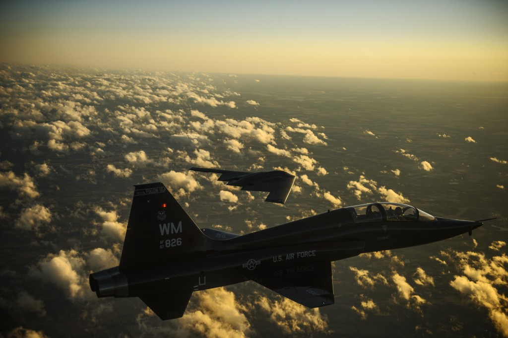 A U.S. Air Force T-38 Talon and B-2 Spirit fly in formation during a training mission Feb. 20, 2014. The B-2 is a multi-role bomber capable of delivering both conventional and nuclear ammunition. Department of Defense photo by Staff Sgt. Jonathan Snyder, U.S. Air Force