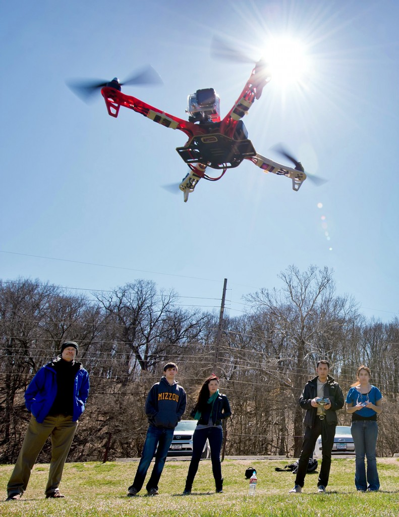 University of Missouri students guide a quad-copter drone off the ground at Columbia's Hinkson Field on June 40, 2014. Today the FAA released proposed rules regarding the regulation of commercial drones. Photo by David Eulitt/Kansas City Star/MCT via Getty Images.