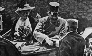 Franz Ferdinand and his wife Sophie riding in an open carriage at Sarajevo shortly before their assassination on June 28, 1914. Photo by Henry Guttmann/Getty Images