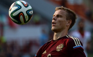 Russia's forward Aleksandr Kokorin bumps the ball with his chest during a pre-World Cup soccer match between Russia and Morocco, in Moscow on June 6. Photo by Vasily Maximov/AFP/Getty Images