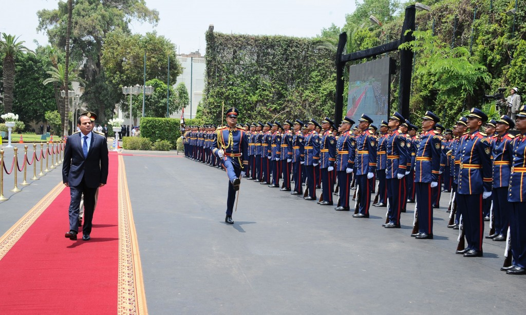 CAIRO, EGYPT - JUNE 8: Egypt's new President Abdel-Fattah al-Sisi reviews the honor guard during the handover ceremony in front of the Ittihadiya presidential palace in eastern Cairo, Egypt on June 8, 2014. Al-Sisi, Egypt's former defense minister, was sworn in by the Supreme Constitutional Court as the country's new president after winning last month's presidential poll. (Egyptian Presidency/Pool/Anadolu Agency/Getty Images)