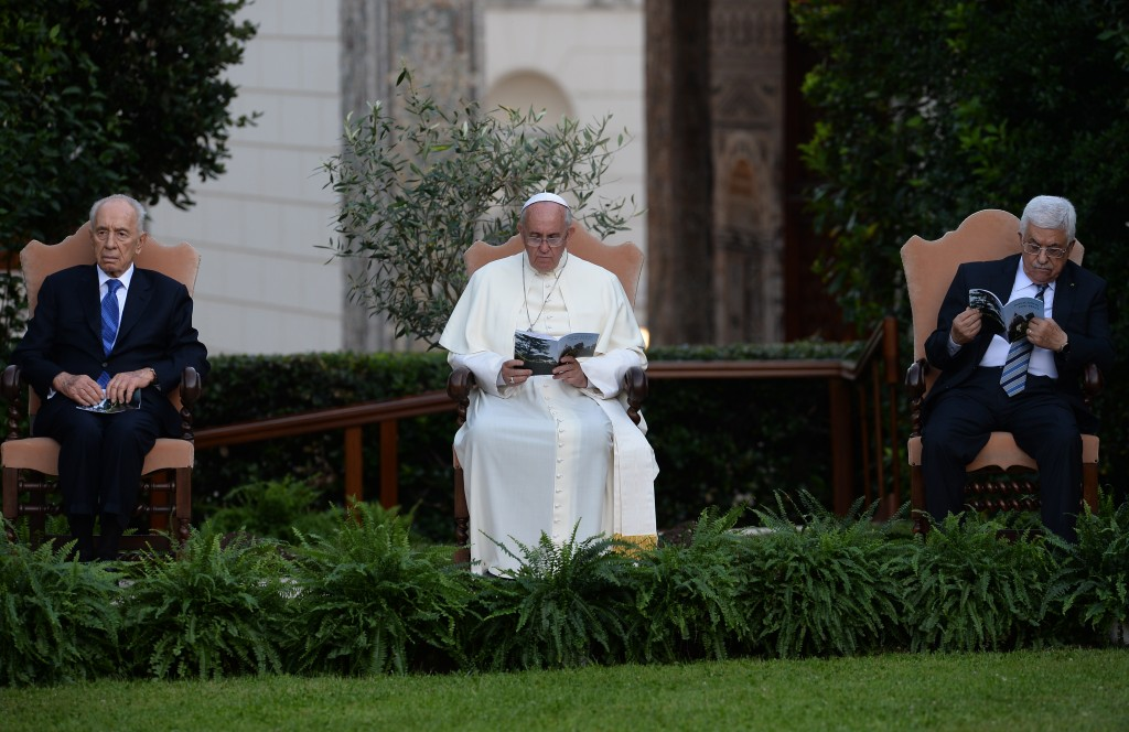 "Pope Francis (C) sits between Palestinian leader Mahmud Abbas (R) and Israeli President Shimon Peres (L) during a joint peace prayer on June 8, 2014 in the gardens of the Vatican. The Vatican has defined the meeting between Israeli President Shimon Peres and Israeli President Shimon Peres as an ""invocation for peace"" but has stressed it will not be an ""inter-religious prayer"", which would have posed problems for the three faiths. In the Vatican Gardens, the prayers will be recited in chronological order of the world's three main monotheistic religions, starting with Judaism, followed by Christianity and then Islam.   AFP PHOTO / FILIPPO MONTEFORTE        (Photo credit should read FILIPPO MONTEFORTE/AFP/Getty Images)"