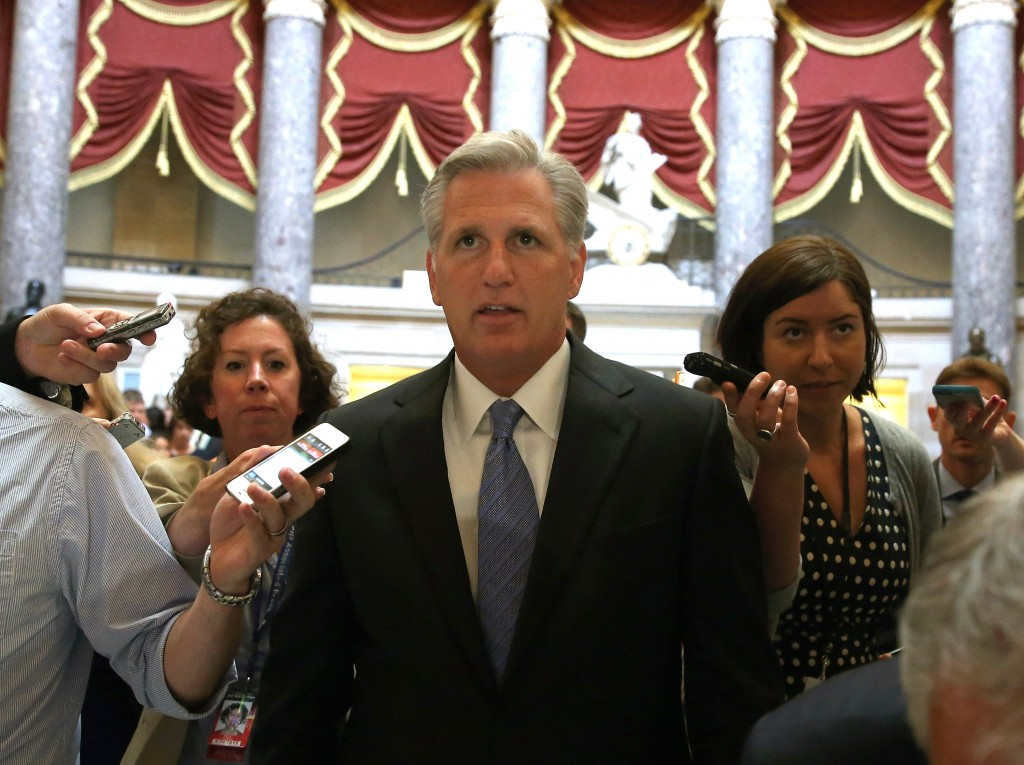 Rep. Kevin McCarthy is trailed by reporters while walking through the U.S. Capitol building June 11. Photo by Mark Wilson/Getty Images