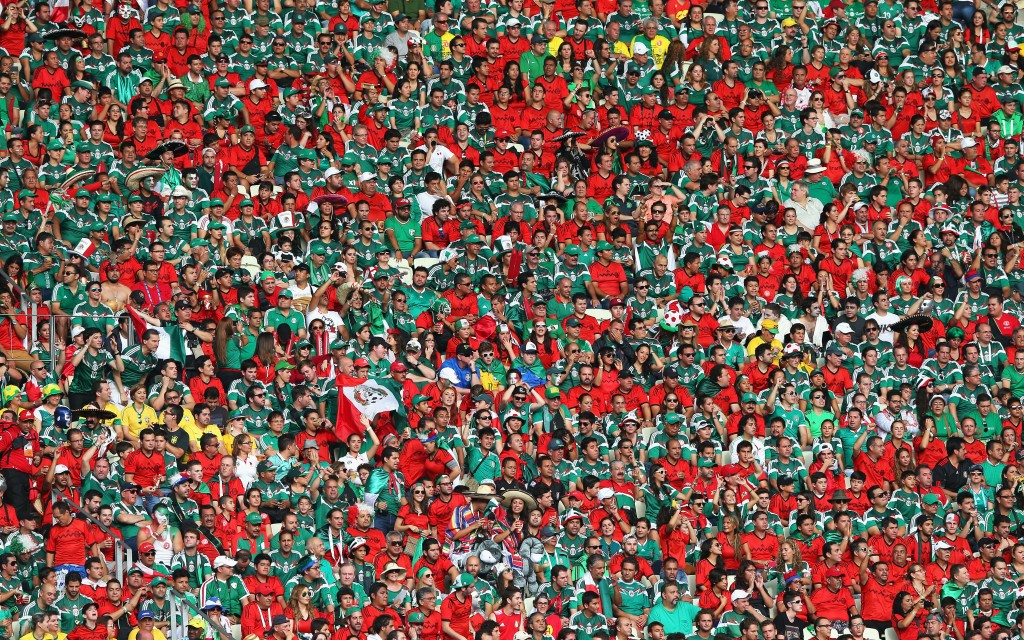 "Fans have come under fire for using racial and homophobic slurs at the World Cup in Brazil. Mexico fans, seen here at the Estadio Castelao on Thursday in Fortaleza, are being investigated for the use of the chant, ""puto,"" which means male prostitute. Photo by Alex LiveseyFIFA via Getty Images"