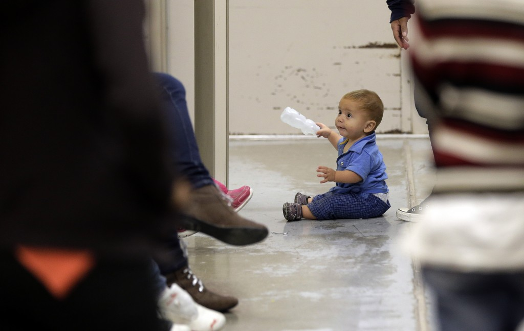 With the surge of migrants, and especially those under 18, detention facilities near the border are being overwhelmed with children. Photo by Eric Gay-Pool/Getty Images