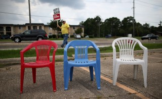 Red, white and blue chairs are set up before the start of a Tea Party Express rally for Mississippi state Sen. Chris McDaniel outside of a Hobby Lobby store Sunday in Biloxi, Mississippi. Photo by Justin Sullivan/Getty Images