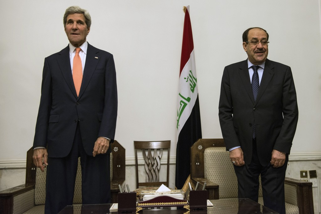 Iraqi Prime Minister Nouri al-Maliki (R) and U.S. Secretary of State John Kerry meet at the Prime Minister's Office in Baghdad on June 23, 2014. Kerry was in Baghdad to push for Iraqi unity and stability, as Sunni militants swept through western towns abandoned by the security forces. Photo by BRENDAN SMIALOWSKI/AFP/Getty Images