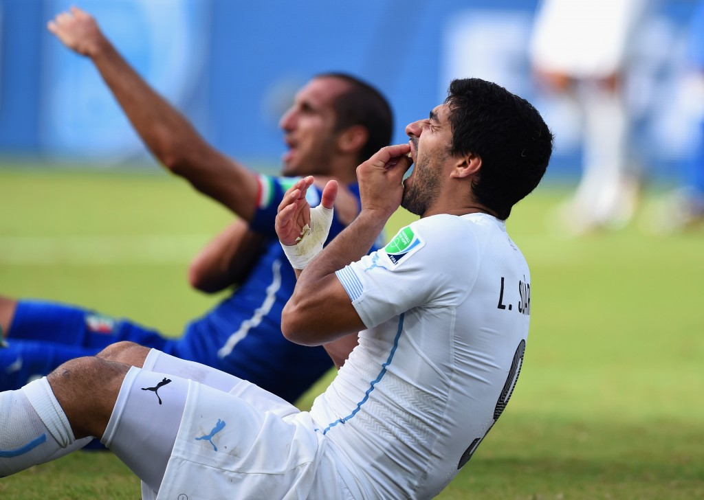 Luis Suarez of Uruguay and Giorgio Chiellini of Italy react after a clash during a World Cup match in Natal, Brazil on June 24. Photo by Matthias Hangst/Getty Images