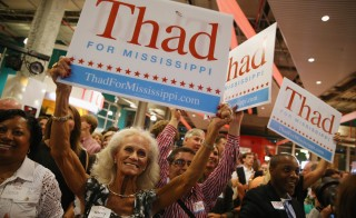Supporters of Sen. Thad Cochran celebrate after his narrow victory over state Sen. Chris McDaniel at the Mississippi Children's Museum Tuesday in Jackson, Mississippi. Photo by Justin Sullivan/Getty Images
