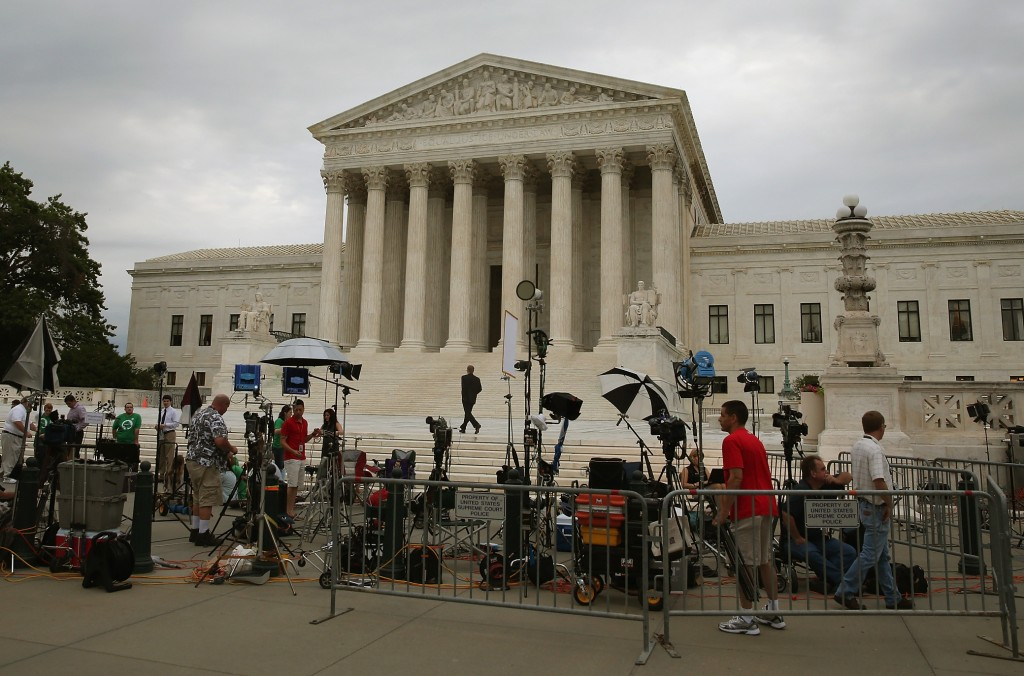 Members of the media set up in front of the U.S. Supreme Court Monday in Washington, DC. Photo by Mark Wilson/Getty Images