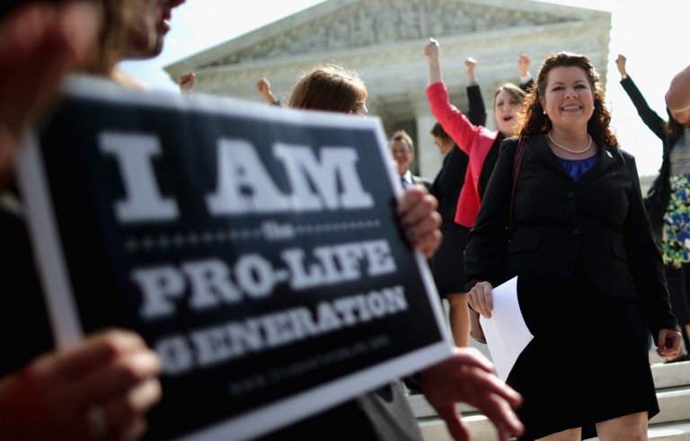 Lori Windham, senior counsel for The Becket Fund for Religious Liberty, joins supporters in front of the Supreme Court after the decision in Burwell v. Hobby Lobby Stores June 30, 2014 in Washington, DC. Photo by Chip Somodevilla/Getty Images