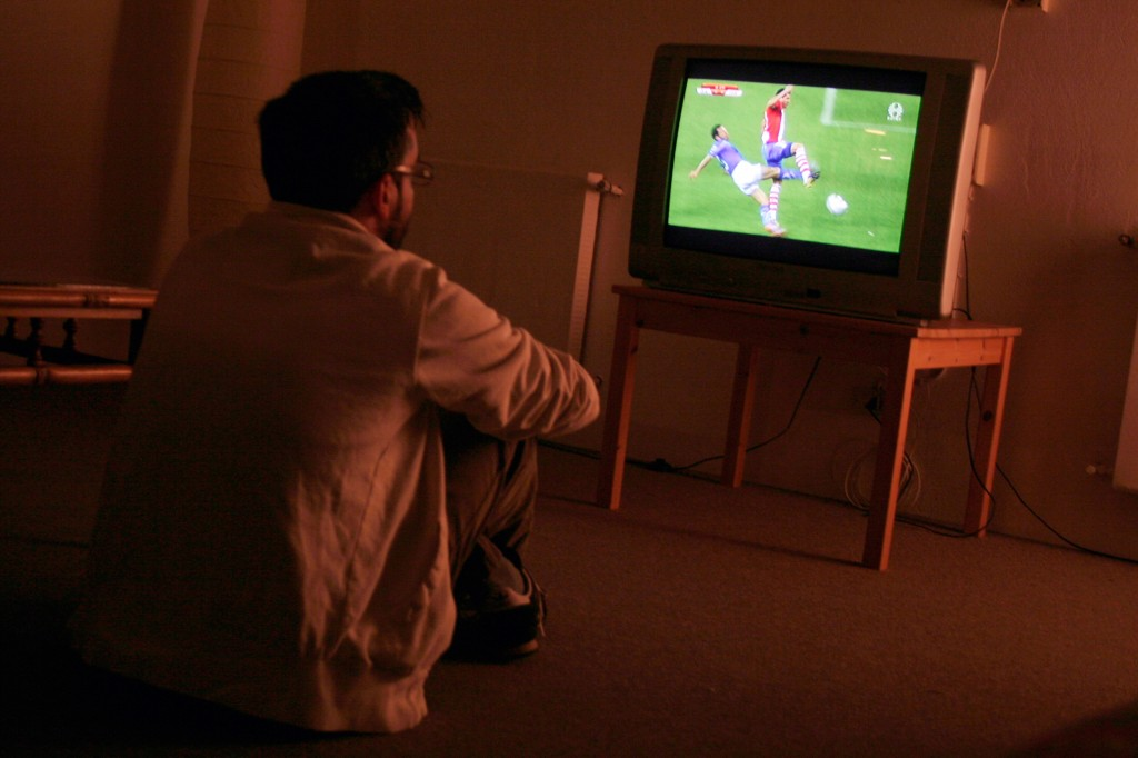Brazil's demand for bigger televisions will drive a surge in e-waste. A man watches the 2010 cup. Photo by Flickr user Straberrymaya