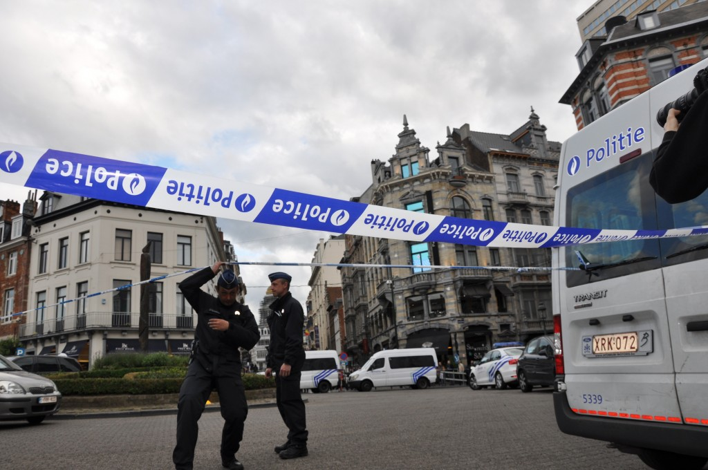 BRUSSELS, BELGIUM - MAY 24: Belgian police take security precautions on Rue Des Minimes as three people were killed and another was seriously wounded in a gun attack Saturday at the Jewish Museum in Brussels, May 24, 2014. (Photo by Feyzullah Yarimbas/Anadolu Agency/Getty Images)