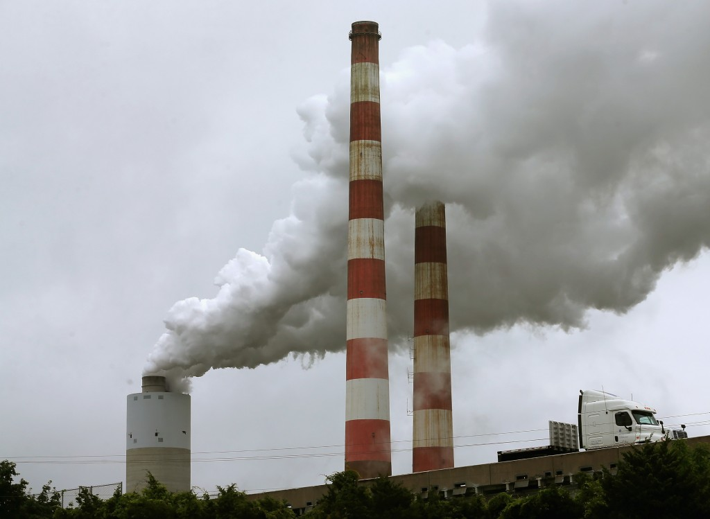 Emissions spew out of a large stack at the coal-fired Morgantown Generating Station in Newburg, Maryland. Photo by Mark Wilson/Getty Images