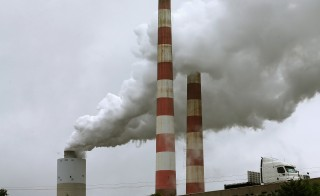 Emissions spew out of a large stack at the coal-fired Morgantown Generating Station in Newburg, Maryland. Photo by Mark Wilson/Getty Images.