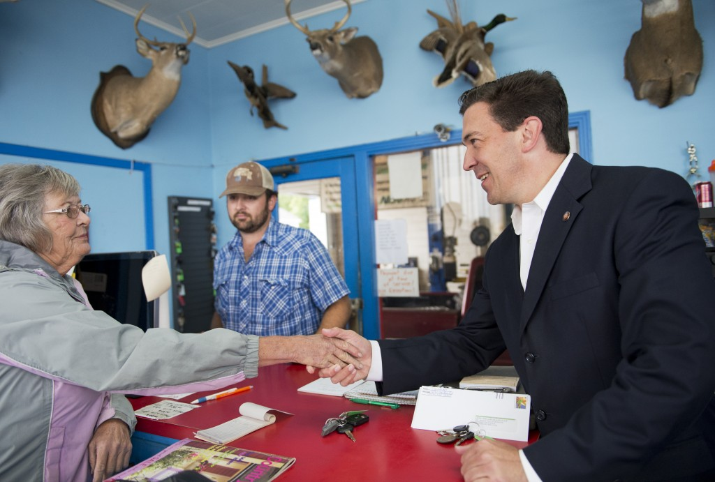 Chris McDaniel, Republican candidate for Mississippi Senate, speaks with an employee of Truhitt Service Center in Union, Miss., May 29. Photo By Tom Williams/CQ Roll Call