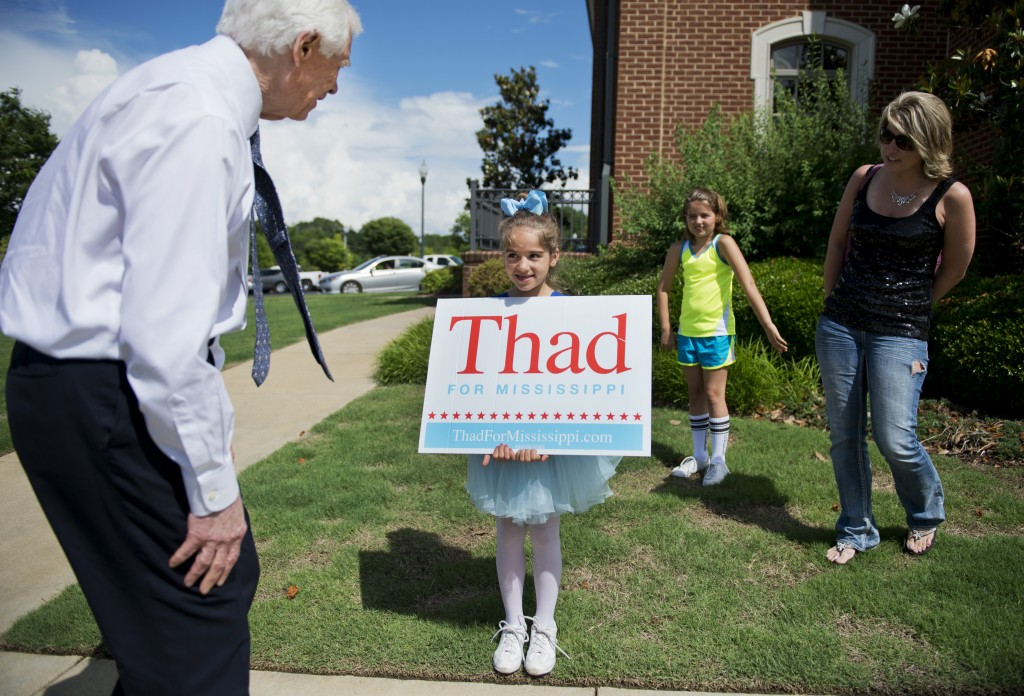 Sen. Thad Cochran, R-Miss., greets a young supporter upon arriving at City Hall in Olive Branch, Miss., May 30. Cochran is facing a re-election challenge from tea party-backed state Sen. Chris McDaniel. Photo By Tom Williams/CQ Roll Call