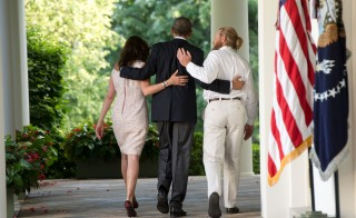 WASHINGTON, DC - MAY 31:  President Barack Obama walks with the parents of Sgt. Bowe Bergdahl, Jani Bergdahl (L) and Bob Bergdahl (R) back to the Oval Office after making a statement regarding the release of Sgt. Bergdahl from captivity May 31, 2014 in the Rose Garden at the White House in Washington, DC. Sgt. Bowe Bergdahl was held captive by militants for almost five years during the war in Afghanistan. (Photo by J.H. Owen-Pool/Getty Images)