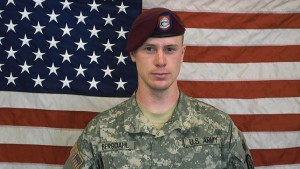 In this undated image provided by the U.S. Army, Sgt. Bowe Bergdahl poses in front of an American flag. Photo by U.S. Army via Getty Images