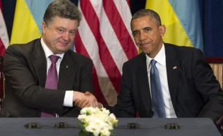 US President Barack Obama and then President-elect Petro Poroshenko of Ukraine hold a meeting in Warsaw, Poland, on June 4, 2014. Photo by Saul Loeb/AFP/Getty Images