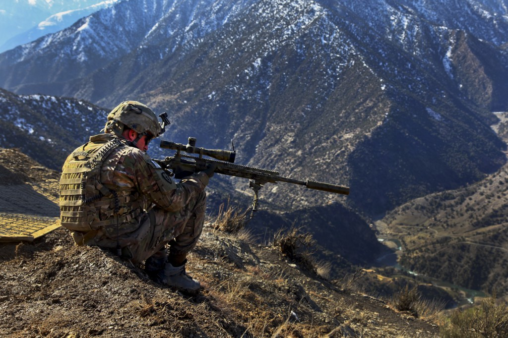 Photo by the U.S. Army Cpl. Kevin Dehaven, Sniper Team Leader, Headquarters and Headquarters Company, 2nd Battalion, 27th Infantry Regiment, 3rd Brigade Combat Team, 25th Infantry Division, provides security, at Observation Post Mangol, Feb. 8, 2012, in the Nari district, Kunar province, Afghanistan.