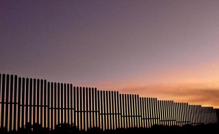 A section of fence along the Rio Grande River, near Brownsville, Tex. Photo by Flickr user latebloomer64