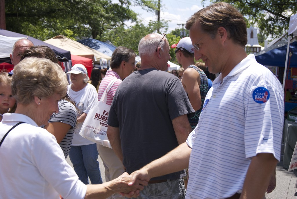 Dave Brat made sure to shake hands with everyone that walked by him at the Ashland Strawberry Faire a week before his win over House Majority Leader Eric Cantor. Photo by Rachel Wellford.