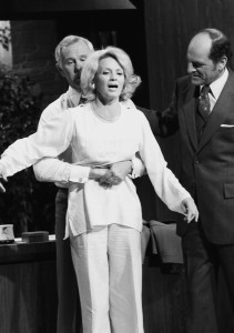 Johnny Carson demonstrates the Heimlich maneuver on actress Angie Dickenson while Dr. Heimlich watches in this April 4, 1979, file photo. Photo by Getty Images