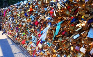 Locks attached to the Pont des Arts bridge in Paris, France. Photo by Photo by Marios Amontaristos/Wikimedia Commons