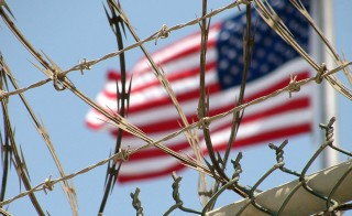 An American flag flies over the detention facility at Guantanamo Bay, Cuba. Photo by Larisa Epatko