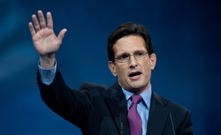 U.S. Republican House Majority Leader Eric Cantor waves after addressing the Conservative Political Action Conference in National Harbor, Maryland, on March 15, 2013. Photo by Nicholas Kamm/AFP/Getty Images