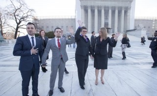 "Plaintiffs Paul Katami, Jeff Zarillo, Kris Perry, and Sandy Stier stand in front of the Supreme Court in ""The Case Against 8."" Photo courtesy of AFER/Diana Walker/HBO"