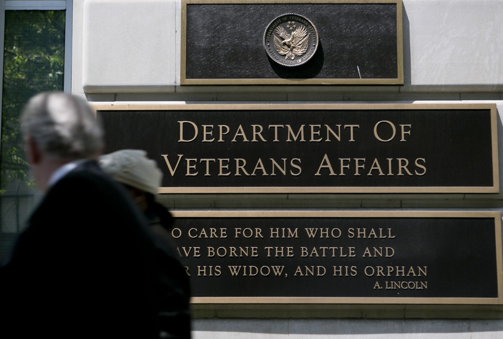 Pedestrians walk past the U.S. Department of Veterans Affairs (VA) headquarters in Washington, D.C. Photo by Andrew Harrer/Bloomberg via Getty Images