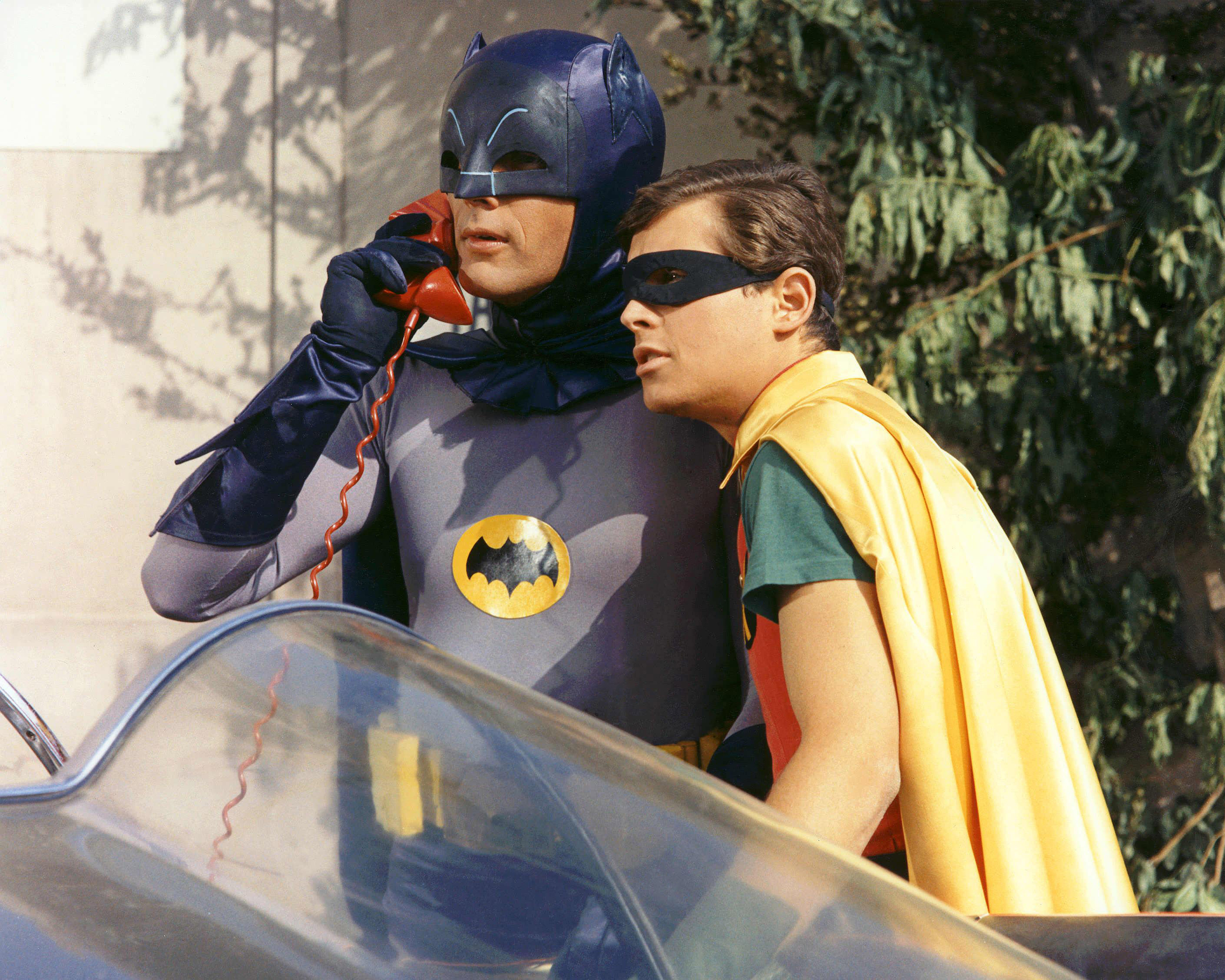 "Adam West and Burt Ward in costume as Batman and Robin for the 1966 television version of ""Batman."" Photo by Silver Screen Collection/Getty Images"