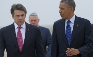 President Obama with Texas Gov. Rick Perry on May 9, 2013 in Austin, Texas. Perry will meet with Obama and faith and local leaders to discuss immigration in Dallas Wednesday. Photo by SAUL LOEB/AFP/Getty Images