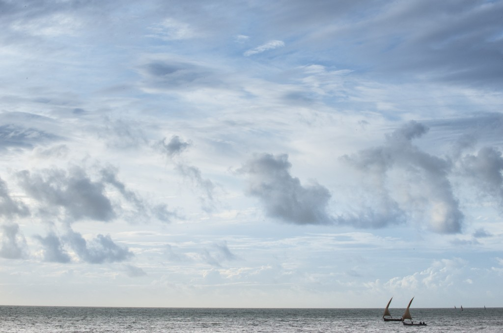 Traditional Swahili dhows sail in the Indian Ocean off the coast of Malindi. Photo by Mia Collis/PBS NewsHour