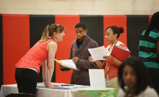 Wendy Larsen (L) speaks to candidates at a job fair on June 12 in Chicago, Illinois. Photo by Scott Olson/Getty Images