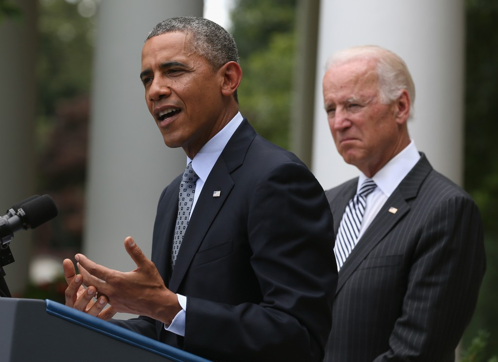President Obama speaks about immigration as Vice President Biden listens in the Rose Garden of the White House Monday. Photo by Mark Wilson/Getty Images