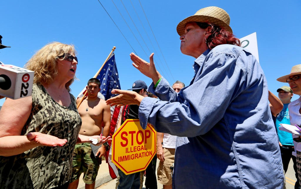 Anti-immigration activists and immigration sympathizers debate during a protest outside of a U.S. Border Patrol Station on July 7 in Murrieta, California.  Photo by Sandy Huffaker/Getty Images