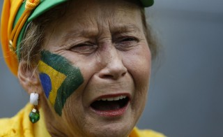 Brazil soccer fan crying