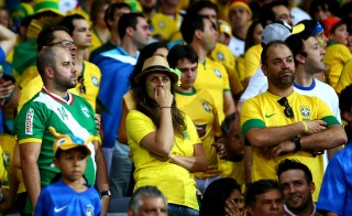 Brazil fans look dejected during the 2014 FIFA World Cup semifinal match between Brazil and Germany at in Belo Horizonte, Brazil, on July 8. Photo by Michael Steele/Getty Images