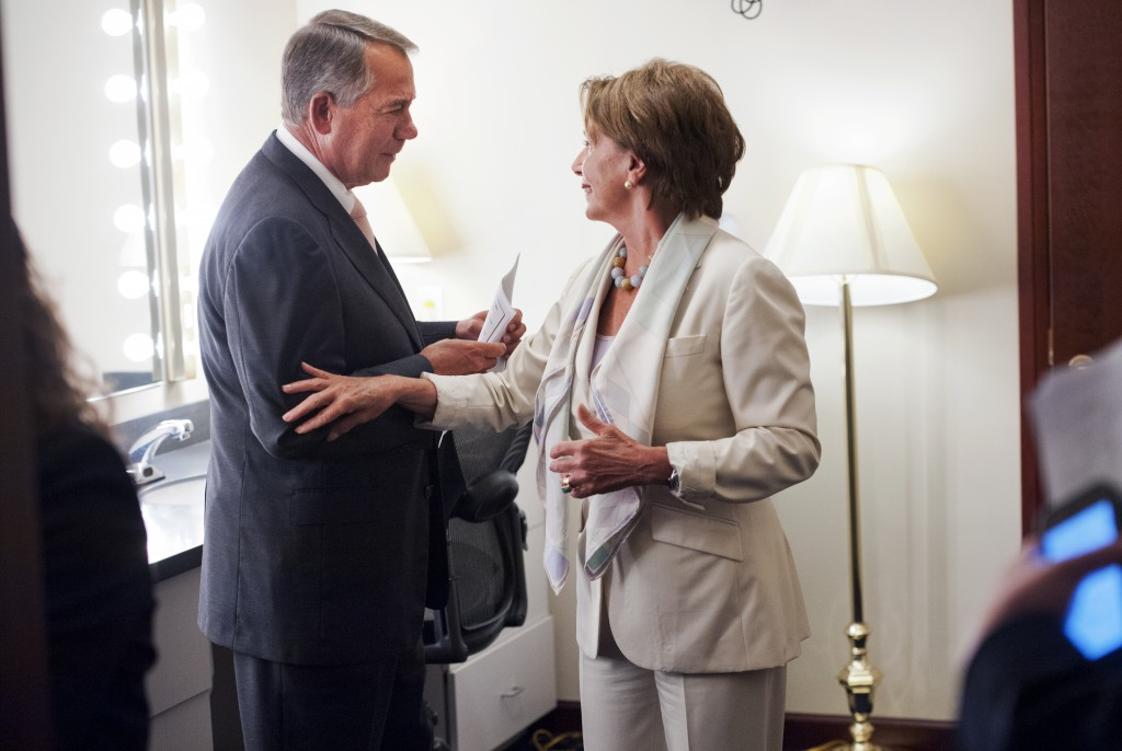 Speaker John Boehner, R-Ohio, and House Minority Leader Nancy Pelosi, D-Calif., run into each other in the green room of  weekly news conference in the Capitol Visitor Center's Studio A, July 10, 2014. Photo By Tom Williams/CQ Roll Call