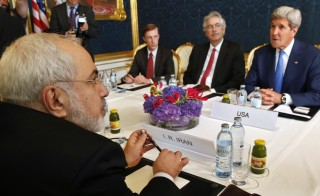 Iran's Foreign Minister Javad Zarif holds a bilateral meeting with U.S .Secretary of State John Kerry on the second straight day of talks over Tehran's nuclear program in Vienna, on July 14, 2014.  Photo by Jim Bourg/AFP/Getty Images