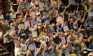 YORK, ENGLAND - JULY 14:  Members of the Church of England's Synod vote on one of the motions during the session to discuss and vote on the consecration of women bishops on July 14, 2013 in York, England. The Synod contradicted tradition today and voted to give women the right to be bishops of the Church of England.  (Photo by Nigel Roddis - WPA Pool/Getty Images)