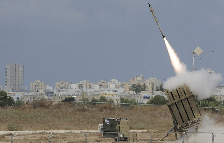 """A missile is launched by an """"Iron Dome"""" battery, a short-range missile defence system designed to intercept and destroy incoming short-range rockets and artillery shells, on July 15, 2014 in southern Israeli. Photo by David Buimovitch/AFP/Getty Images"""