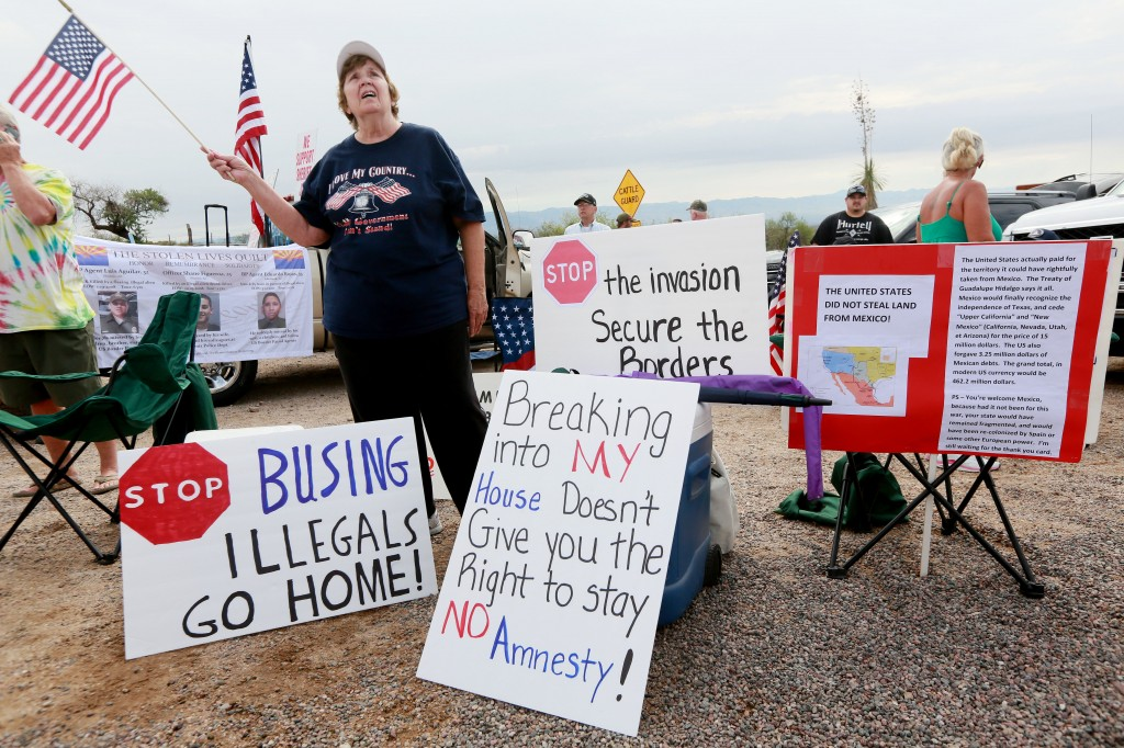 Anti-immigration activist Judy Lairmore holds a sign during a protest in Oracle, Arizona in anticipation of buses carrying illegal immigrants on Tuesday. Photo by Sandy Huffaker/Getty Images