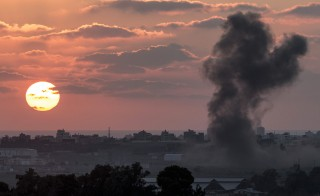 A picture taken from the Israeli Gaza border shows smoke billowing from the Gaza Strip following an Israeli air strike on July 16, 2014. Photo by Jack Guez/AFP/Getty Images